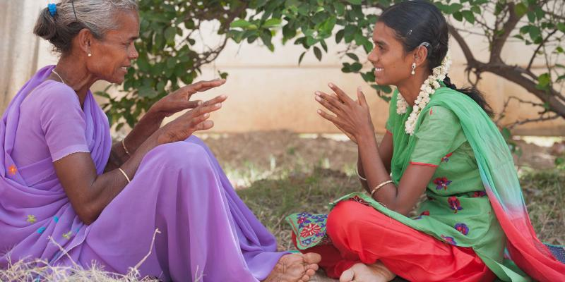 Alugumani and her mother use sign language