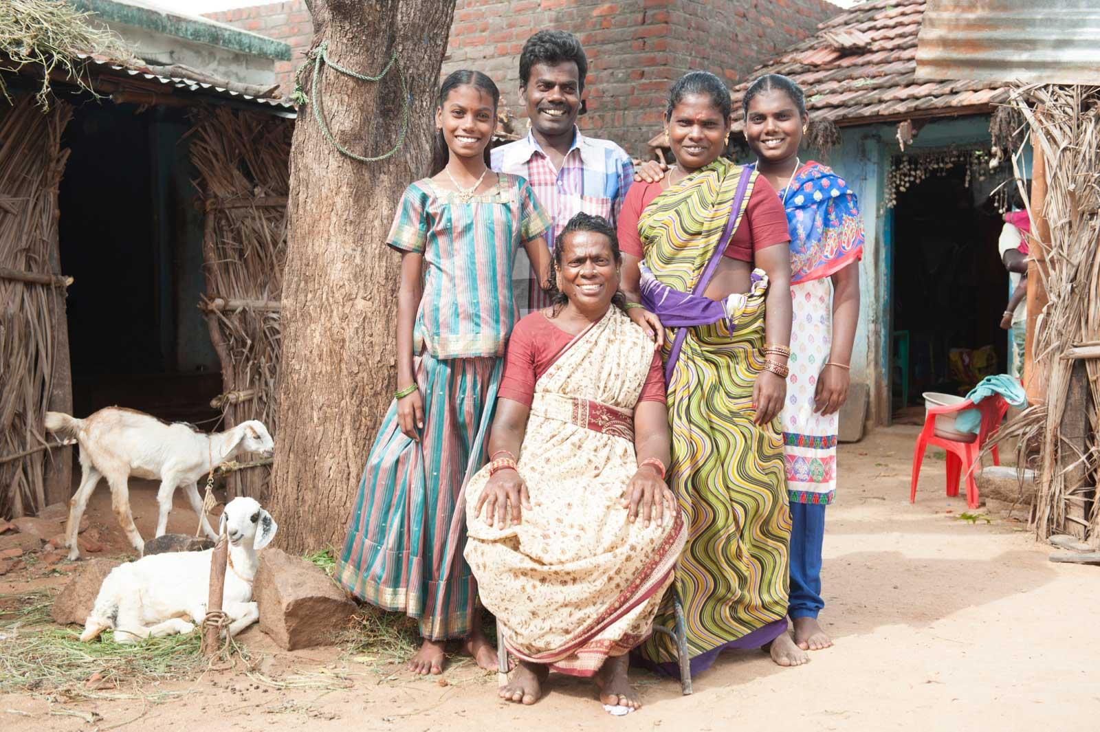 Annandhi with her family in front of their house
