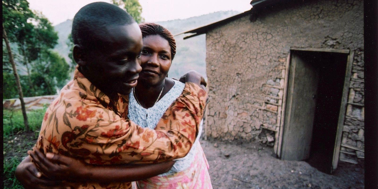 Bwami and his mum outside their house