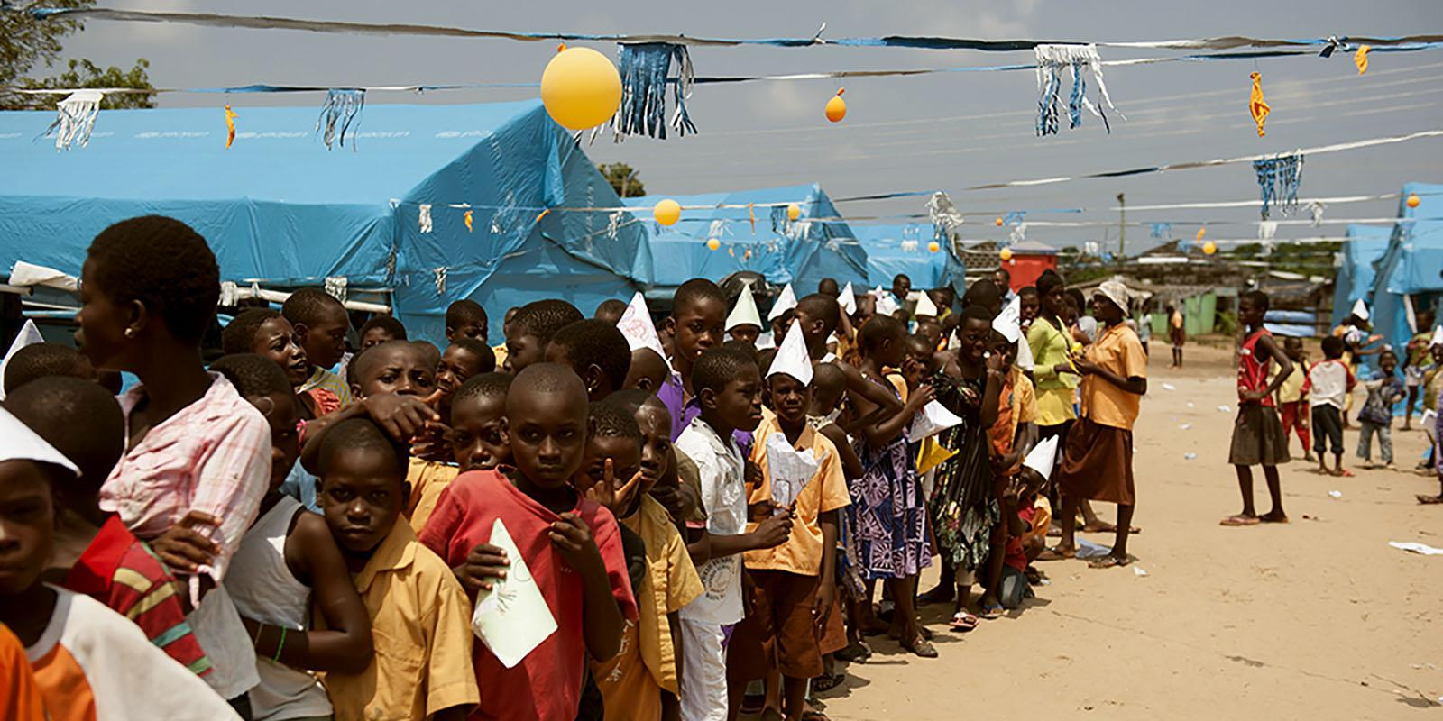 Children queing up to vote in a refugee camp