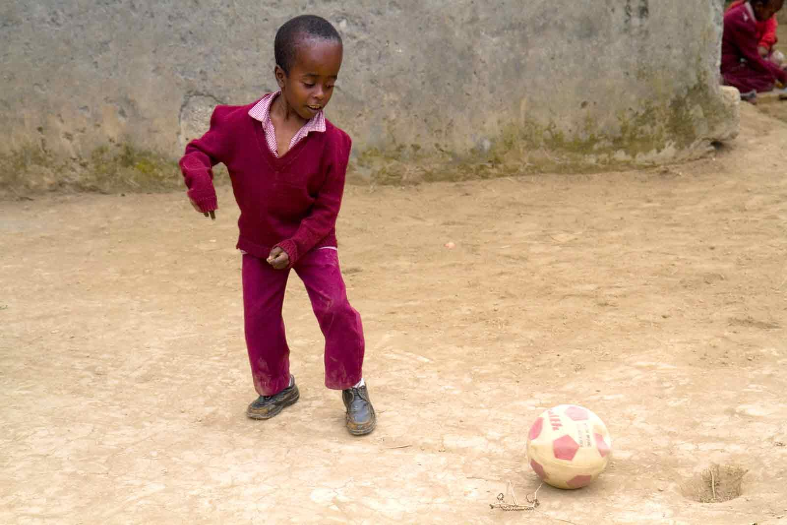 Boy with disabilities plays football