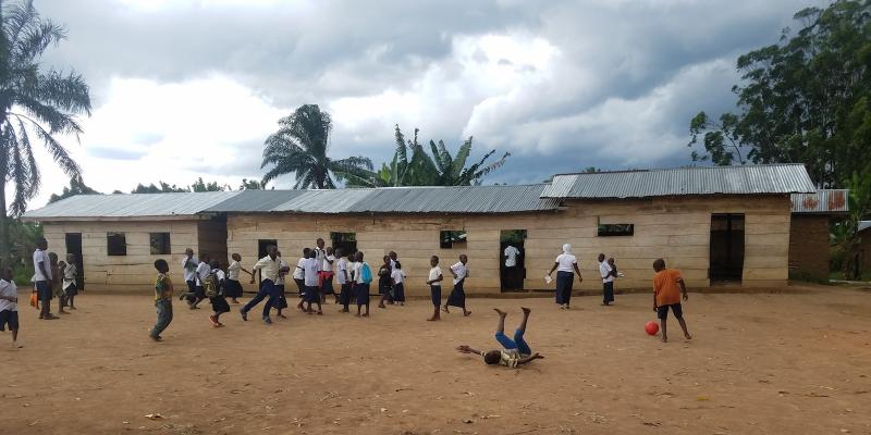 Children playing outside their school