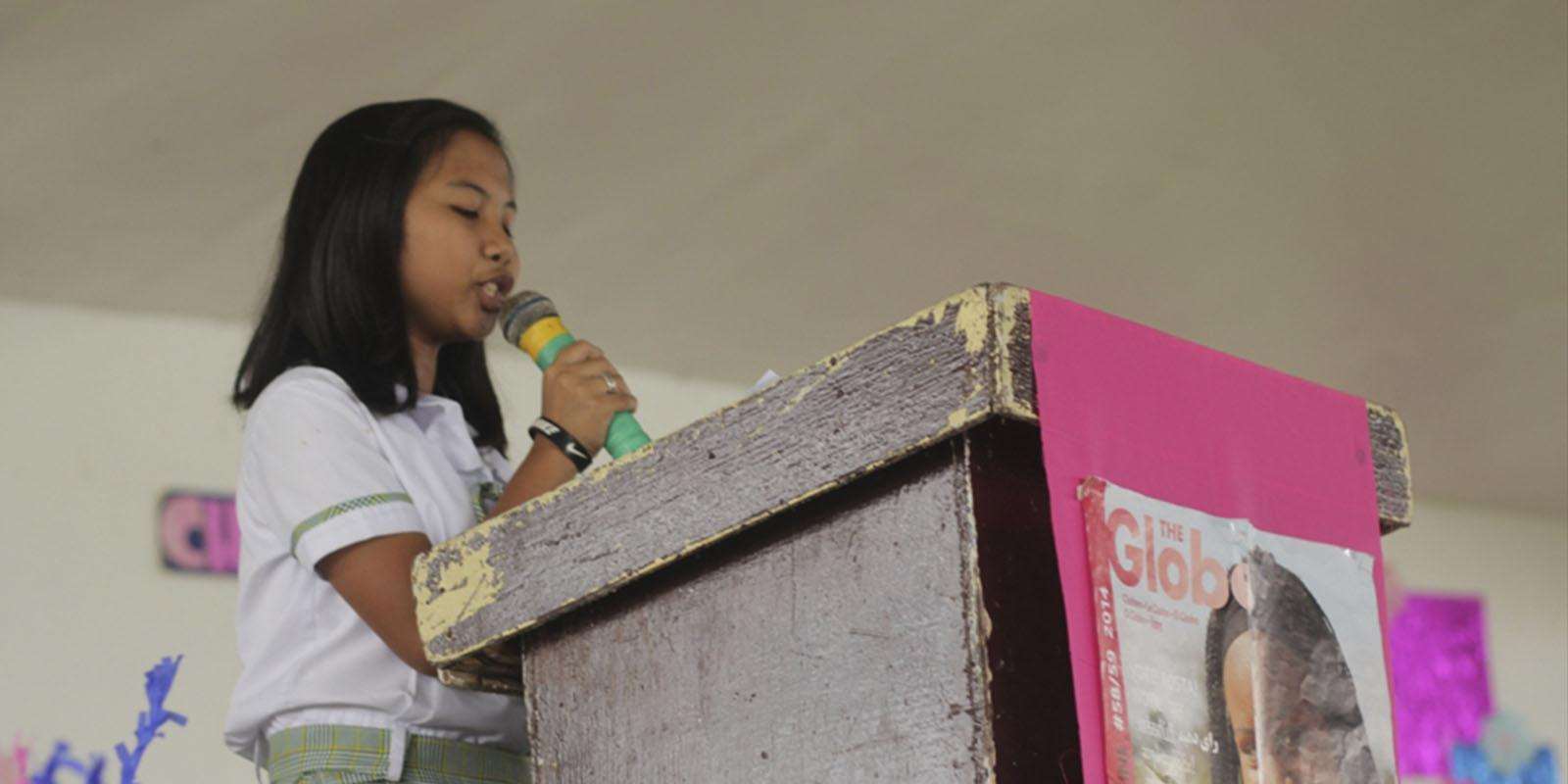 Girl on podium speaking
