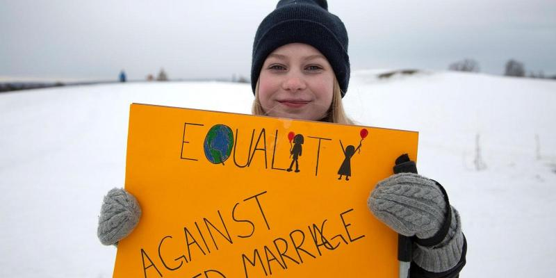 Girl holding sign for equality