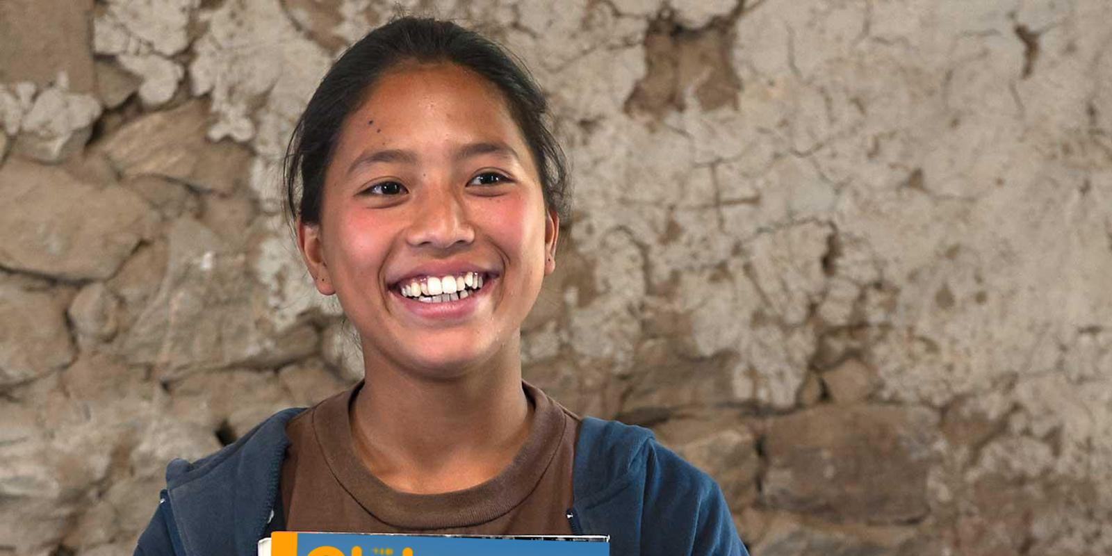 Girl from Nepal holding magazine