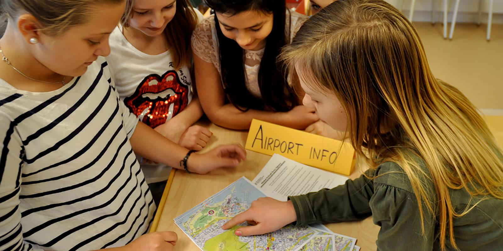 Group of girls looking at a map
