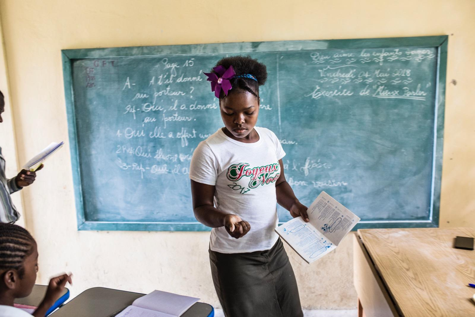 A girl in a classroom.