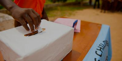 Hand casting ballot in box