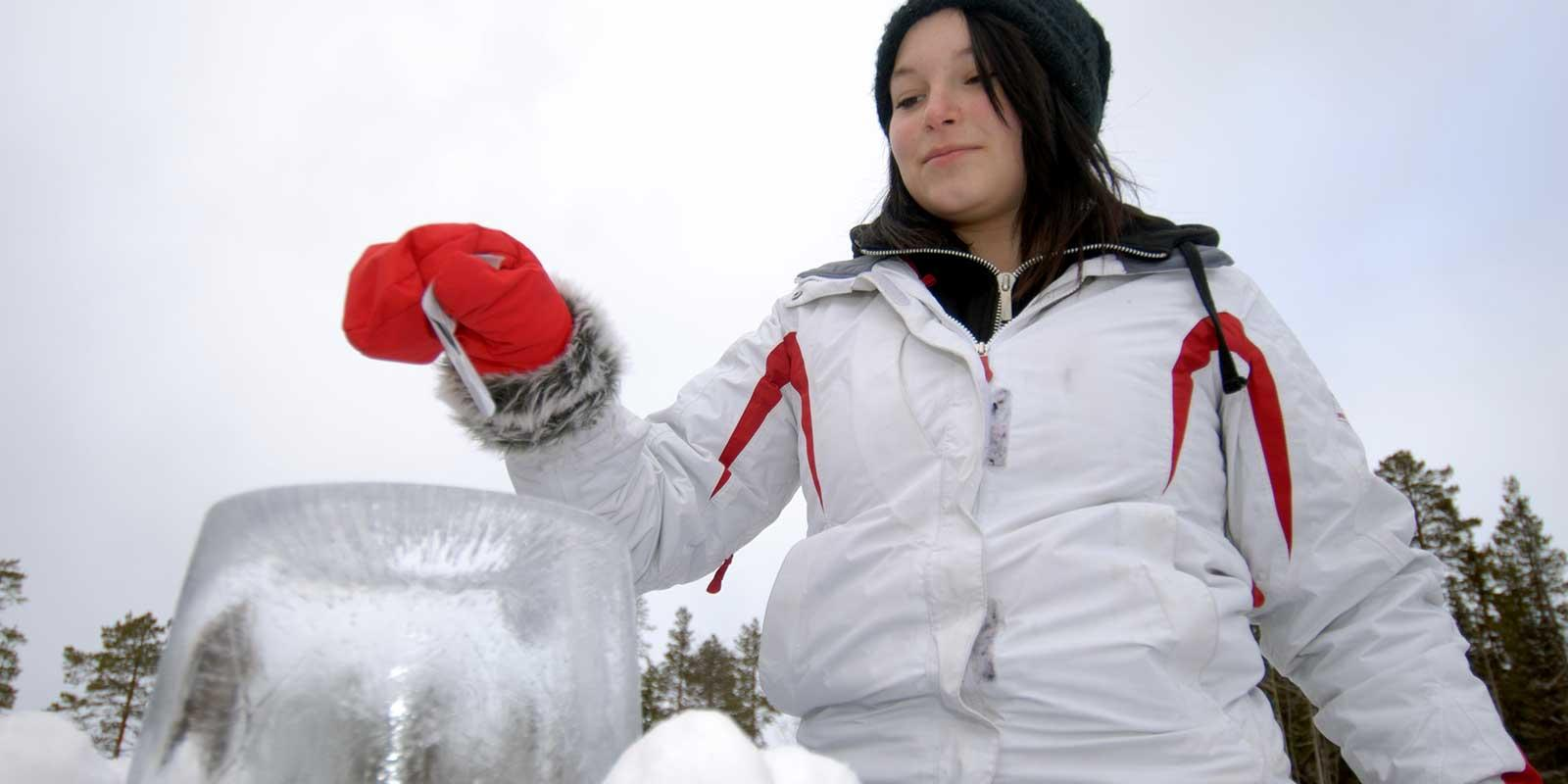 Girl putting ballot in ice ballot box