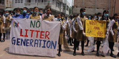 School children in India holding NO LItter Generation signs