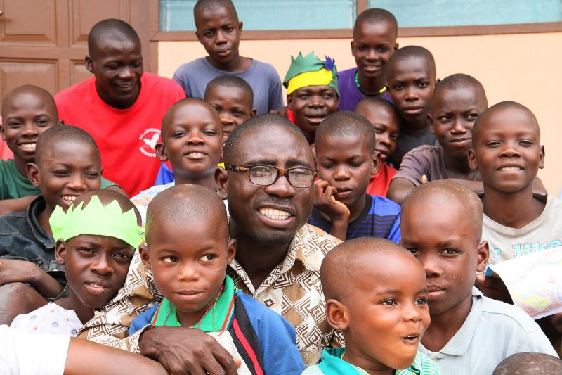James Kofi Annan with children