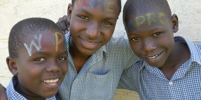 three children with facepaint