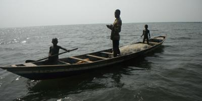 Two small boys and a man in a fishing boat
