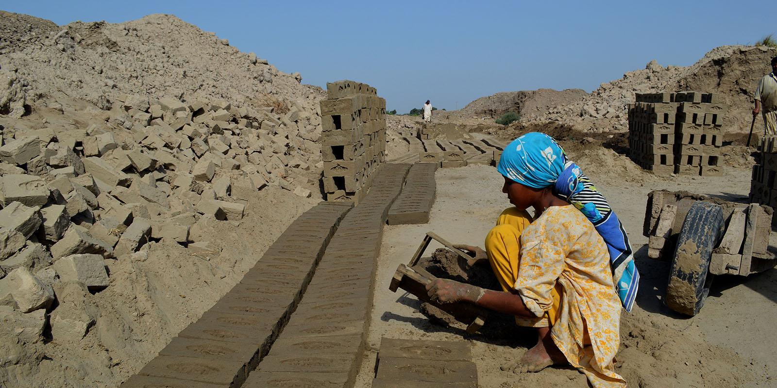 Nosheen making bricks under hot sun