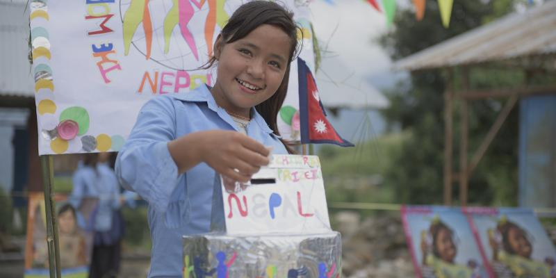 Phulmaya, a girl from Nepal, casts her vote