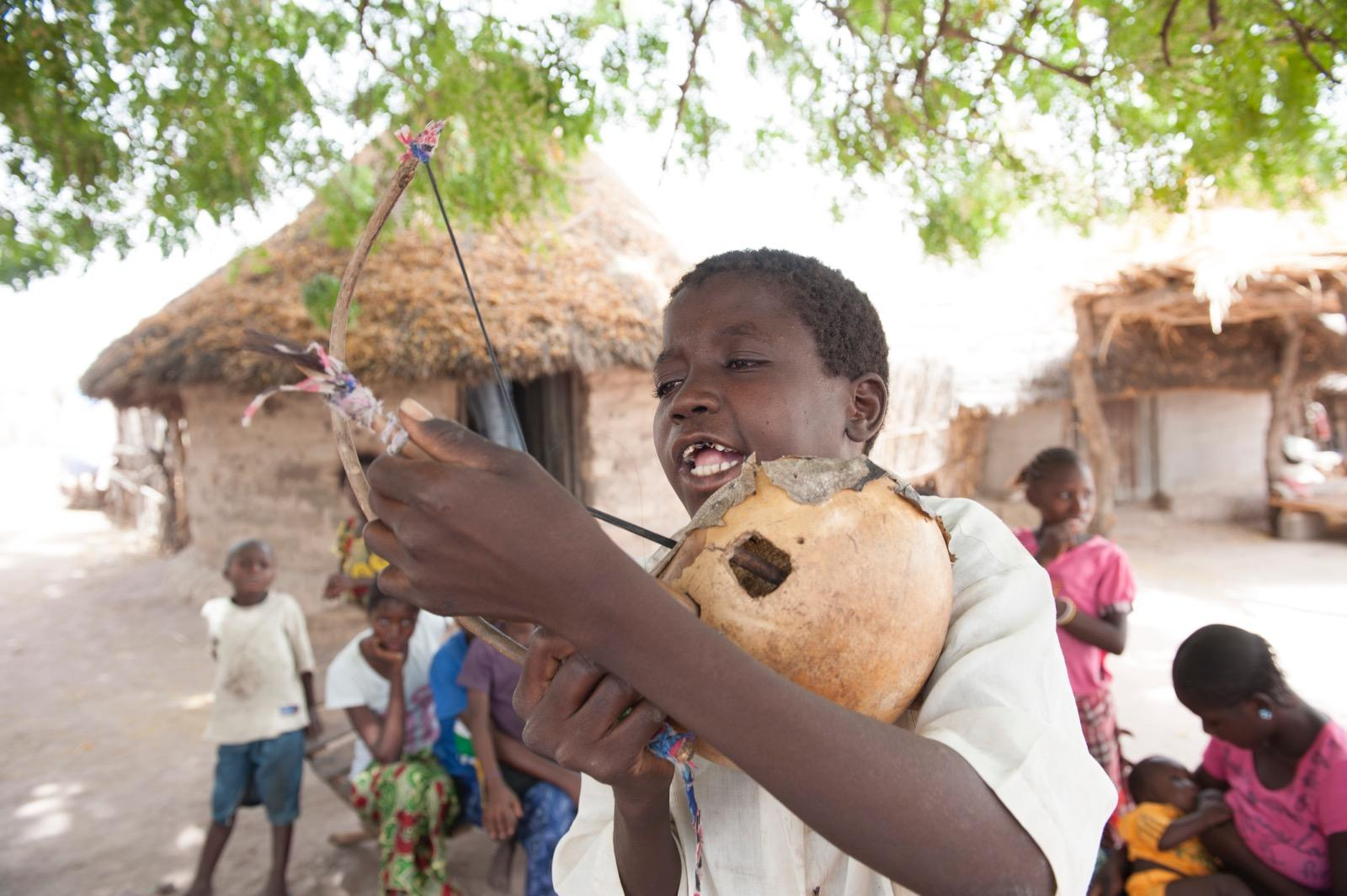 Boy playing instrument