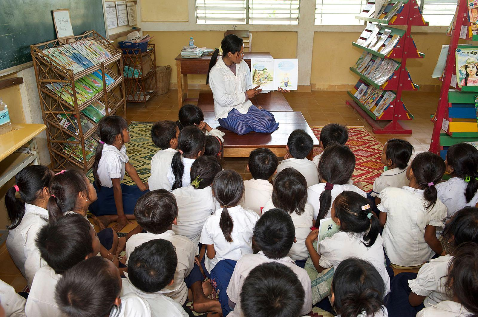 Children gather in library in floating village