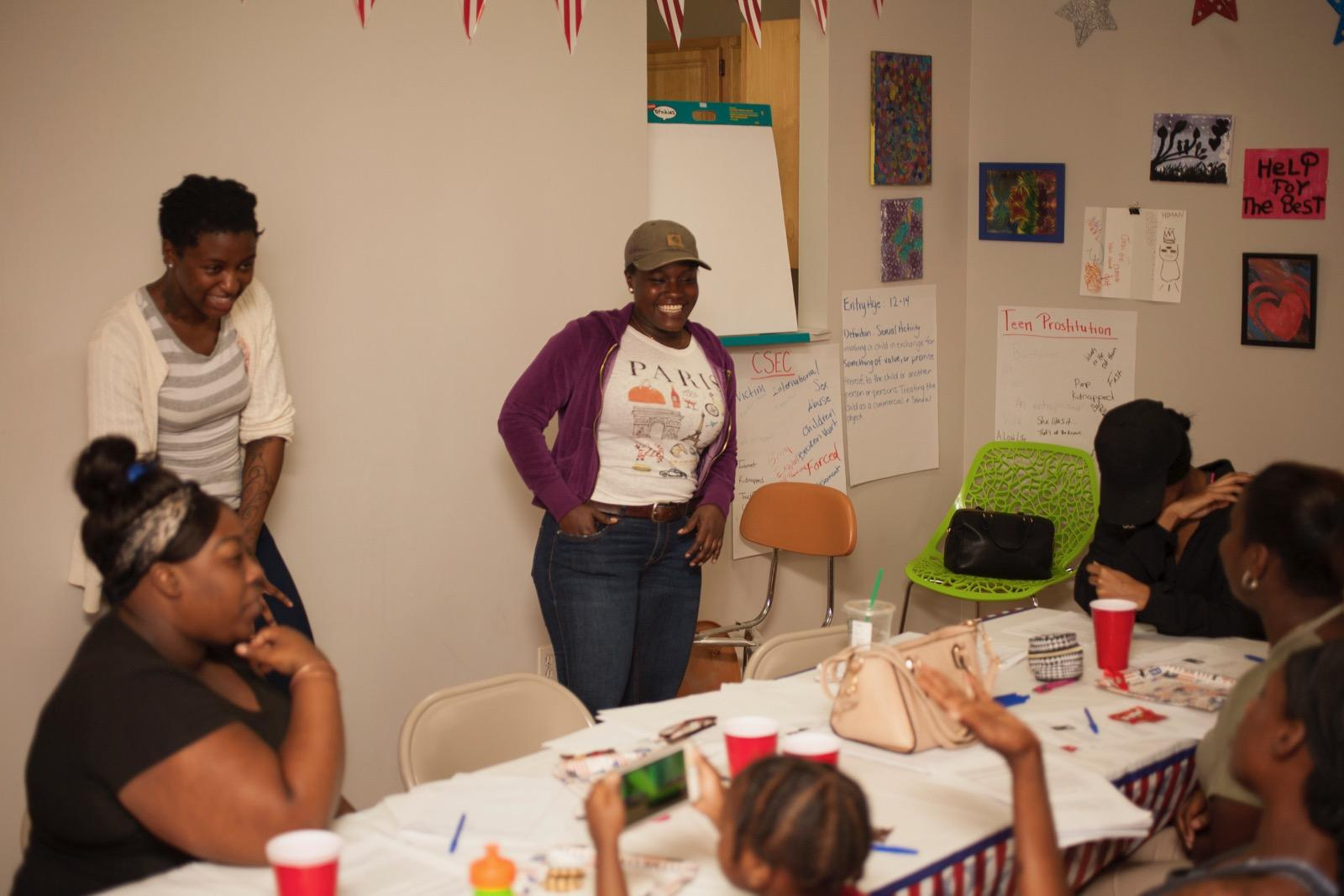 Shaquana holding workshop with girls