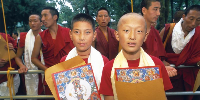 Two Tibetan boys and several Monks