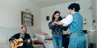 Svetlana dancing with her mother while her father playing guitar