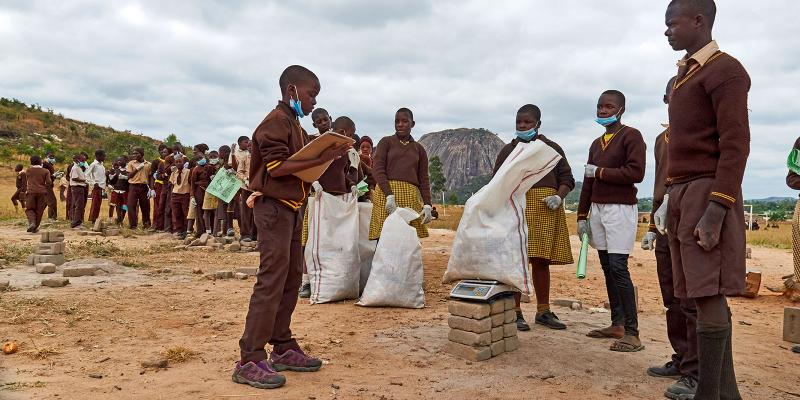 Children collecting and weighing litter