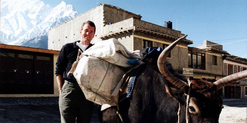 John Wood with fully loaded yak in Nepal mountains