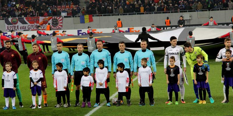 Children and players in Romanian football stadium