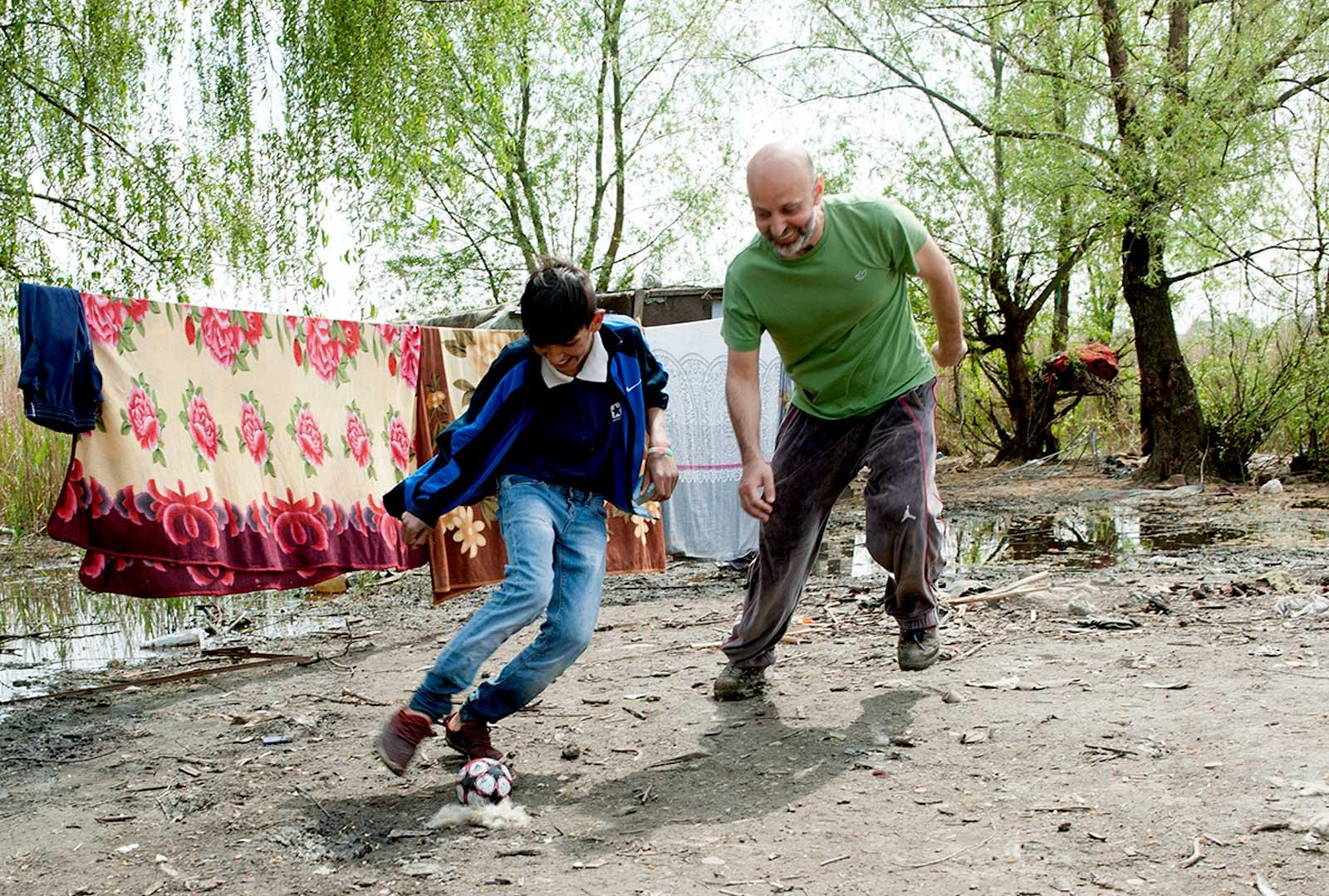 Valeriu and boy playing football