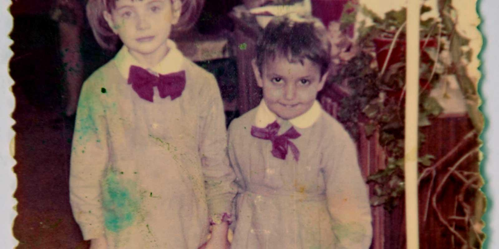 Valeriu as a boy, holding a girl's hand.