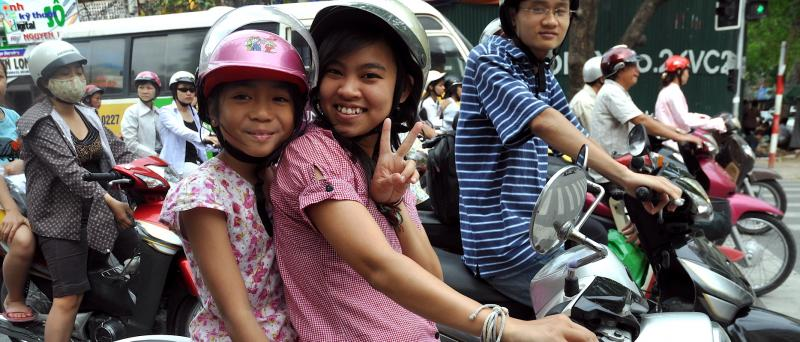 Two girls on a motorbike in Hanoi