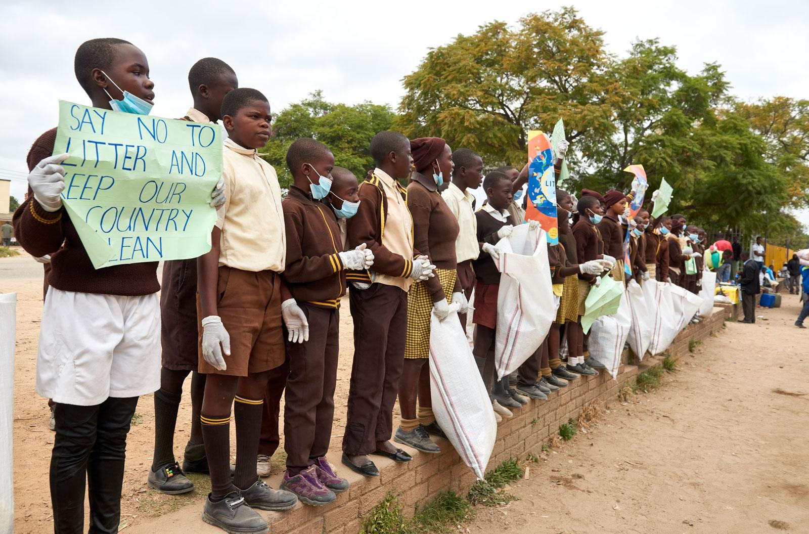 Children demonstrating with signs