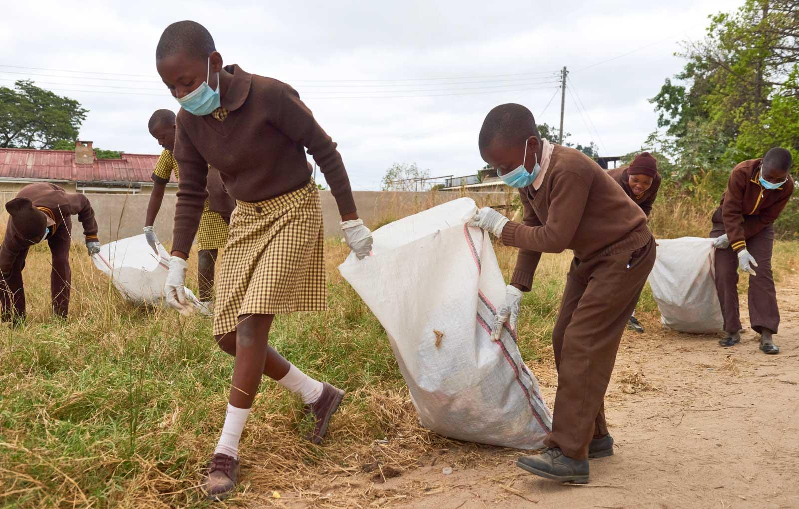 Kids collecting trash